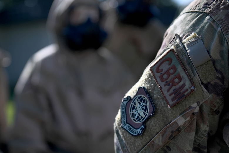 A CBRN patch is on the arm of an Airman.