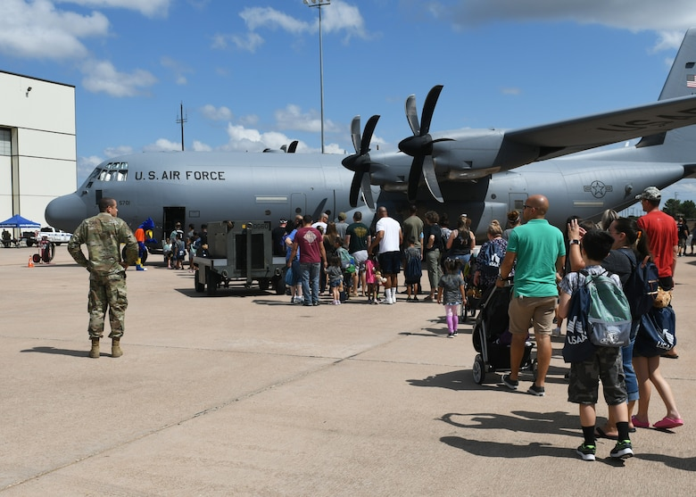 Families wait to board a C-130J Super Hercules aircraft during Operation Dyess Kids at Dyess Air Force Base, Texas, Sept. 28, 2019.
