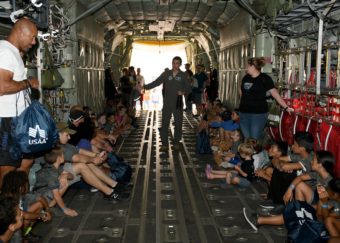 1st Lt. Alexander Bollwitt, 40th Airlift Squadron C-130J Super Hercules pilot, middle, briefs children on their mission during Operation Dyess Kids on Dyess Air Force Base, Texas, Sept. 28, 2019.