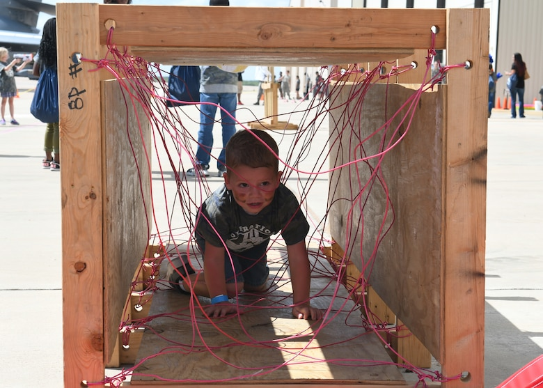 Rhett Griffin, son of Airman 1st Class Benjamin Griffin, 317th Aircraft Maintenance Squadron C-130J Super Hercules crew chief, crawls through an obstacle course during Operation Dyess Kids at Dyess Air Force Base, Texas, Sept. 28, 2019.