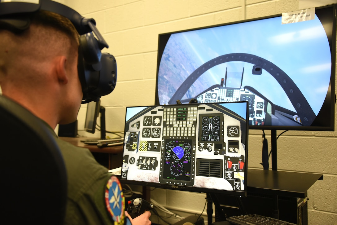 80th Flying Training Wing student pilot, flies a T-38C Talon through a mixed reality environment during a training session