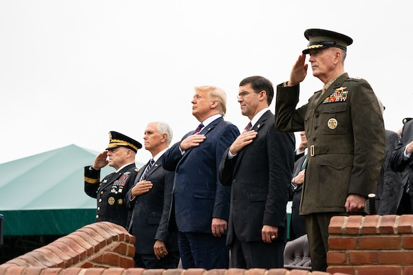 Army Gen. Mark A. Milley, incoming Chairman of the Joint Chiefs of Staff; Vice President Mike Pence; President Donald J. Trump; Secretary of Defense Dr. Mark T. Esper; and Marine Corps Gen. Joe Dunford, outgoing Chairman, render honors during an Armed Forces Welcome Ceremony as Army Gen. Mark A. Milley becomes the 20th Chairman of the Joint Chiefs of Staff, at Joint Base Myer – Henderson Hall, Va., Sept. 30, 2019. Milley takes the reigns from Marine Corps Gen. Joe Dunford, the 19th Chairman of the Joint Chiefs of Staff.