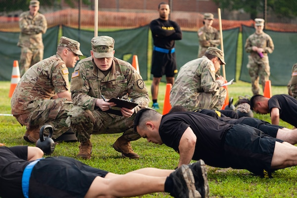 Staff Sgt. Gabriel Wright, a signals intelligence analyst with the 780th Military intelligence Brigade, grades the Hand-Release Push-Up event May 17, 2019, as part of Army Combat Fitness Test Level II Grader validation training, held at Fort Meade, Maryland.