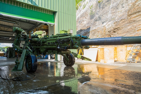 A U.S. Marine with the 2nd Marine Division cleans an M777 prior to staging it in a Marine Corps Prepositioning Program-Norway cave facility. The Marines have used Norwegian storage facilities since 1981. DLA Disposition Services helps remove items that no longer fit the mission needs.
