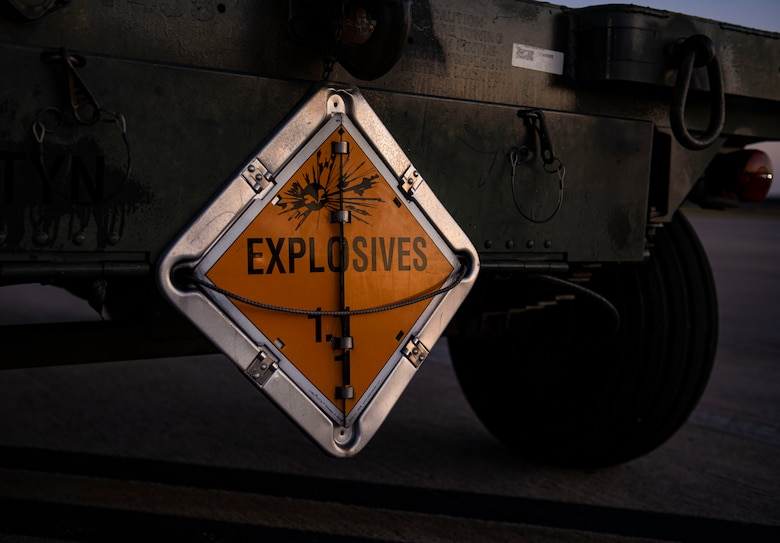 "An ""EXPLOSIVES"" sign warns of potential hazards on the flightline during Combat Archer 19-12 on Tyndall Air Force Base, Fla., Sept. 24, 2019. Combat Archer is part of the 53rd Wing's Weapons System Evaluation Program. (U.S. Air Force photo by Airman 1st Class Bailee A. Darbasie)"