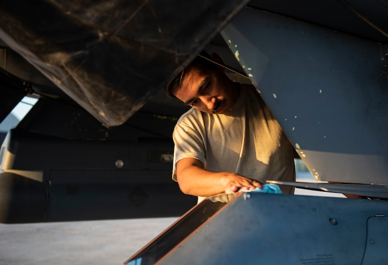 Airman 1st Class Bonifacio Garcia, 757th Aircraft Maintenance Squadron tactical aircraft maintainer, cleans an F-15E Strike Eagle fighter jet during Combat Archer 19-12 on Tyndall Air Force Base, Fla., Sept. 24, 2019. Combat Archer is the Department of Defense's largest air-to-air live fire missile employment exercise. (U.S. Air Force photo by Airman 1st Class Bailee A. Darbasie)
