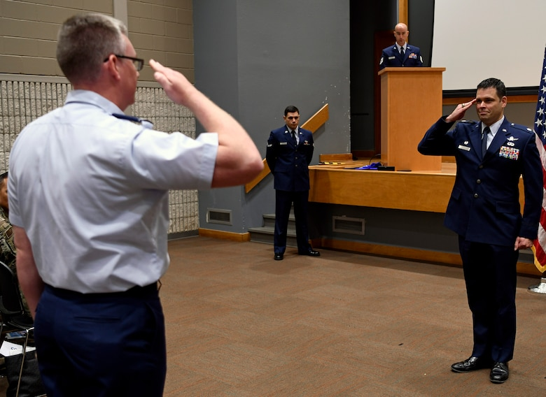 Lt. Col. Peter Francik (right), 318th Range Squadron commander, accepts his first salute as commander during a ceremony at Joint Base San Antonio-Lackland, Texas, Oct. 1, 2019. The 318th RANS was also activated during the ceremony. (U.S. Air Force photo by Tech. Sgt. R.J. Biermann)