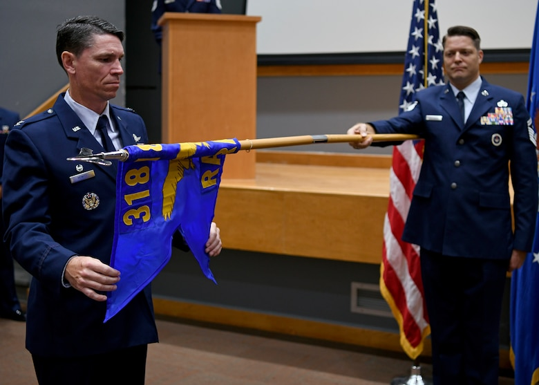 Col. James Hewitt, 318th Cyberspace Operations Group commander, unfurls the 318th Range Squadron guidon flag during the squadron's activation ceremony at Joint Base San Antonio-Lackland, Texas, Oct. 1, 2019. Lt. Col. Peter Francik also assumed command during the ceremony. (U.S. Air Force photo by Tech. Sgt. R.J. Biermann)