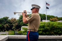 U.S. Marine Corps Sgt. Caleb Franklin, a trumpet player with the U.S. Marine Corps Forces, Pacific Band, plays taps during National Prisoner of War/Missing in Action (POW/MIA) Recognition Day at the National Memorial Cemetery of the Pacific, Honolulu, Sept. 20, 2019. National POW/MIA Recognition Day honors those who were prisoners of war and who are still missing in action. (U.S. Marine Corps photo by Cpl. Matthew Kirk)