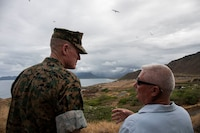 U.S. Marine Corps Maj. Gen. Edward D. Banta (left), commanding general, Marine Corps Installations Command (MCICOM), listens to Daniel S. Geltmacher, Range Manager, Marine Corps Base Hawaii (MCBH), discuss the Ulupa'u Wildlife Management Area during his visit to MCBH, Sept. 25, 2019. The purpose of the tour was to assess the installation's readiness capability first hand as the newest commanding general of MCICOM, as well as to discuss issues it faces. Banta toured the schools, training facilities, base housing, construction of new housing and new medical center. (U.S. Marine Corps photo by Pfc. Samantha Sanchez)