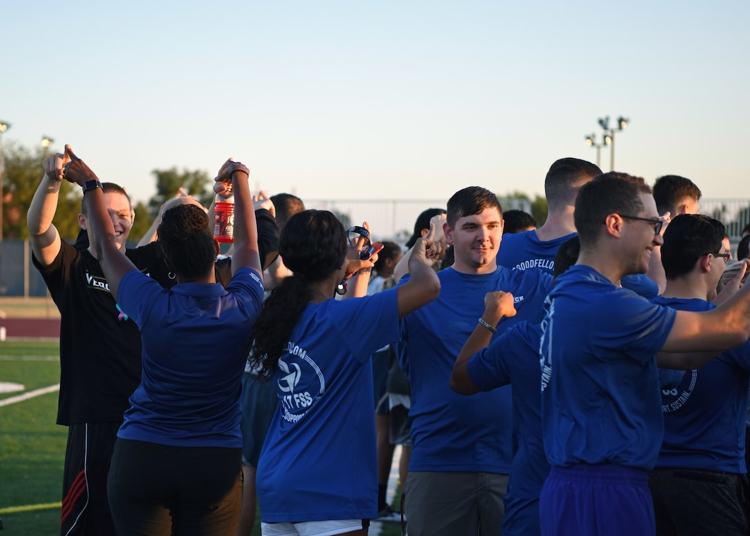 """Members of Goodfellow Air Force Base """"connect"""" before the 24-Hour Suicide Prevention Run/Walk to meet new people and start conversations at Goodfellow Air Force Base, Texas, Sept. 27, 2019. The event encouraged people to talk, connect, and find people they can rely on. (U.S. Air Force photo by Airman 1st Class Ethan Sherwood/Released)"""