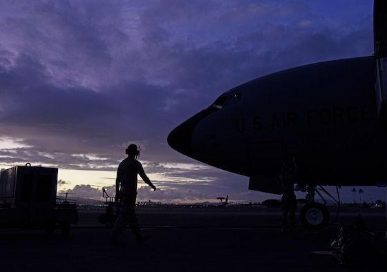 Team Fairchild flying crew chiefs perform a post flight check at Joint Base Pearl Harbor-Hickam, Hawaii, Sept. 17, 2019. To become a pilot, students must understand the basics to theory of flight, air navigation, meteorology, flying directives, aircraft operating procedures and mission tactics. (U.S. Air Force photo by Senior Airman Jesenia Landaverde)