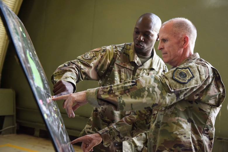 U.S. Air Force Vice Chief of Staff Stephen W. Wilson receives a briefing from Master Sgt. Kevin Grimes, 39th Security Forces Squadron non-commissioned officer in charge of security operations, during a visit to Incirlik Air Base, Turkey, Sept. 29, 2019. Wilson's tour of the installation included visits to various squadrons, in which he observed demonstrations of their mission readiness. (U.S. Air Force photo by Staff Sgt. Joshua Magbanua)