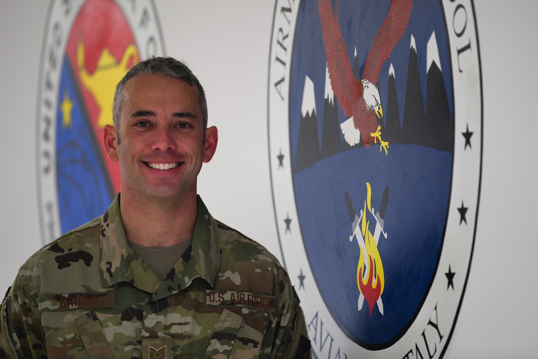 U.S. Air Force Tech. Sgt. Christopher Carey, a 31st Force Support Squadron ALS Instructor, poses for a photo, Sept. 25, 2019, at Aviano Air Base, Italy. The 31st FSS includes several distinct mission support functions that include Military Personnel, Civilian Personnel, Manpower and Organization, Airmen & Family Readiness, Education Services, Airman Leadership School and the First Term Airman Center. (U.S. Air Force photo by Airman 1st Class Ericka A. Woolever).
