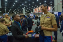 Claude King, a senior at Hampton University, discuss career opportunities with Gunnery Sgt. Latyra Sayers, a career recruiter with Recruiting Station San Diego, during a National Society of Black Engineers conference career fair in Detroit, Michigan, March 28. NSBE is holding its 45th annual national convention consisting of various programs and workshops that are designed to benefit grade school, collegiate, technical, professional and international attendees and the U.S. Marine Corps is a partner organization. Marines partner with organizations like NSBE to ensure its message of opportunity reaches diverse audiences. (U.S. Marine Corps photo by Lance Cpl. Mitchell Collyer)