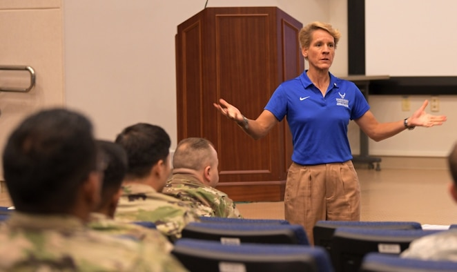 "U.S. Air Force Col. (ret) Laurel ""Buff"" Burkel addresses the audience during her presentation for the Air Force element resiliency stand down Sept. 27, 2019, at U.S. Forces Korea Headquarters on Camp Humphreys, South Korea. Throughout her address, Burkel includes photos of of her rehabilitation after her neck was broken in a helicopter crash in Afghanistan. (U.S. Army photo by Sgt. Austin Fox/Released)"