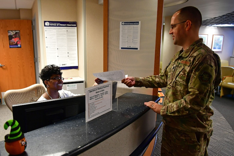 Lt. Col. Micah Schmidt, 19th Medical Group chief of medical staff, demonstrates checking in for an appointment.