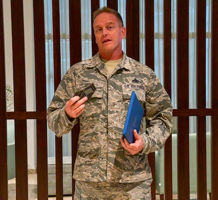 Senior Master Sgt. D.J. Little, 94th Maintenance Squadron hydraulics technician, speaks to a group at his promotion ceremony in Portugal on Sept. 30, 2019.