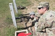 From left to right, Staff Sgt. Edward French, Pvt. Peter Meyer, and Spc. Ben Marinchek, Civil Affairs Specialists with Company A, 414th Civil Affairs Battalion, record the results of Marinchek's M240B machine gun qualification table at Fort Custer, MI on September 14, 2019.