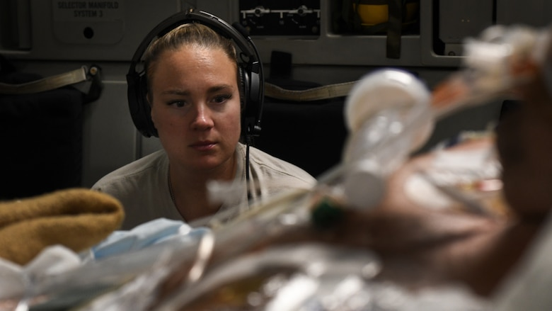 Capt. Natasha Cardinal, 86th Aeromedical Evacuation Squadron critical care nurse, monitors her patient during a flight from Bagram Airfield, Afghanistan to San Antonio, Texas, Aug. 18, 2019. Critical care air transport teams are rapidly deployable teams consisting of a physician, critical care nurse and a respiratory therapist who provide a mobile intensive care unit for complex, critically wounded patients. (U.S. Air Force photo by Airman 1st Class Ryan Mancuso)