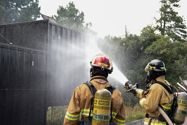 Firefighters at Cheyenne Mountain Air Force Station, Colorado, train in order to fight fires in a variety of settings, Sept. 6, 2019. Their duty station includes 560 acres of forested land and the massive Cheyenne Mountain Complex underneath Cheyenne Mountain. (U.S. Air Force photo by Airman Alexis Christian)