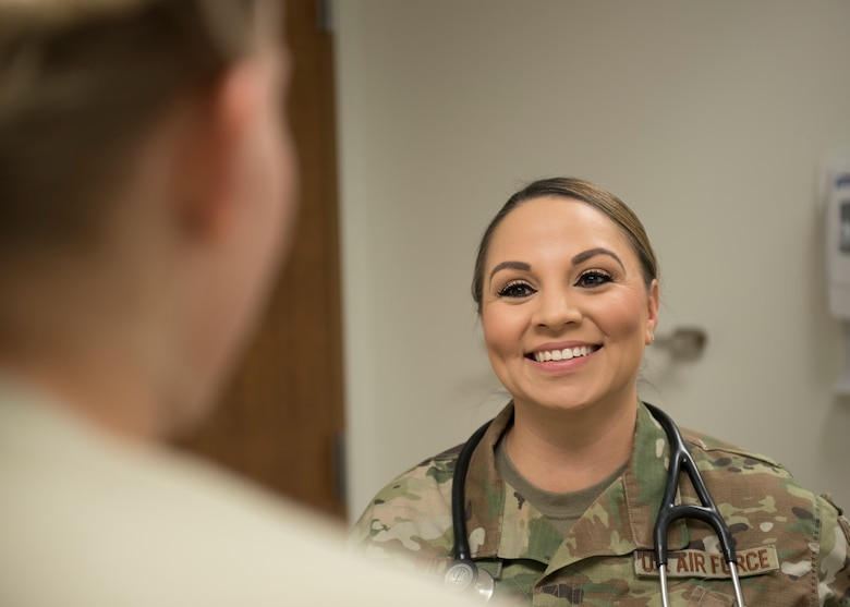 Tech. Sgt. Jerrica Wild, 21st Operational Medical Readiness Squadron independent duty medical technician, speaks to a patient at the clinic on Peterson Air Force Base, Colorado, September 25, 2019. Wild is also stationed at Cheyenne Mountain Air Force Station and provides care to the personnel there, alleviating the pressure of manning resources by patients not having to travel. (U.S. Air Force photo by Airman Alexis Christian)