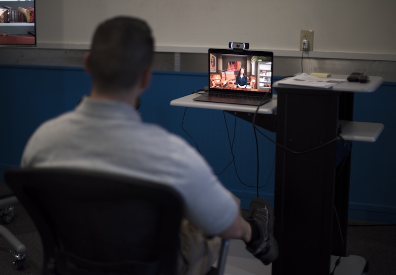 """U.S. Air Force Capt. John Hoffecker, 204th Intelligence Squadron flight commander, listens to an artificial intelligence presentation during a live simulation – mixing reality leadership experience in a Flight Commander Course on Joint Base McGuire-Dix-Lakehurst, New Jersey, Sept. 27, 2019. Incorporating the AI simulation into the class teaches the importance of improving Air Force squadrons by empowering one of Chief of Staff of the U.S. Air Force General David L. Goldfein's line of efforts of """"Strengthen Squadron Leadership and Culture."""" (U.S. Air Force photo by Airman 1st Class Ariel Owings)"""