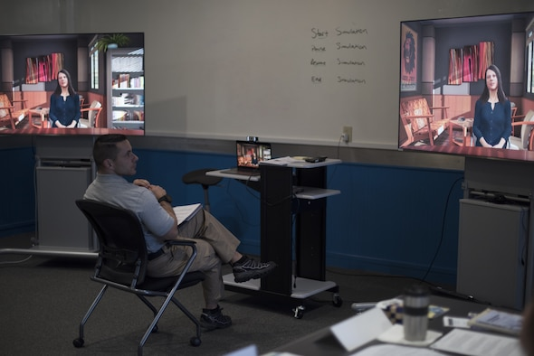 Flight Commander Course students discuss different interpersonal communication techniques to use during a live simulation – mixing reality leadership experience with artificial intelligence on Joint Base McGuire-Dix-Lakehurst, New Jersey, Sept. 27, 2019. The AI implemented gives perspective on how to take care of Airmen and is an effort to restore readiness at the fundamental fighting organization of the United States Air Force – the squadron. (U.S. Air Force photo by Airman 1st Class Ariel Owings)