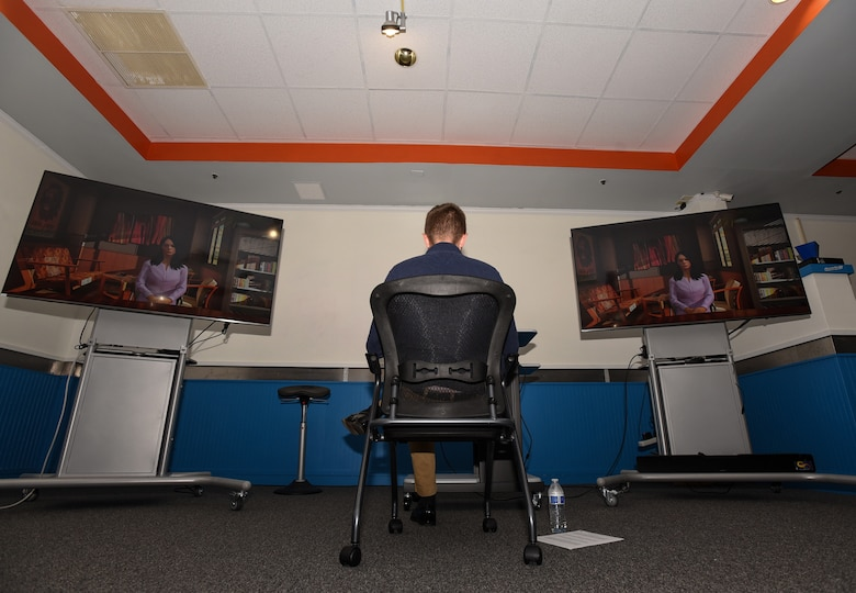 A Flight Commander Course student interacts with artificial intelligence in a live simulation – mixing reality leadership experience during the class capstone event on Joint Base McGuire-Dix-Lakehurst, New Jersey, Sept. 27, 2019. The simulation was conducted for the first time in Air Mobility Command to allow potential leaders to see processes and techniques used by different students on how to handle stressful situations. (U.S. Air Force photo by Airman 1st Class Ariel Owings)