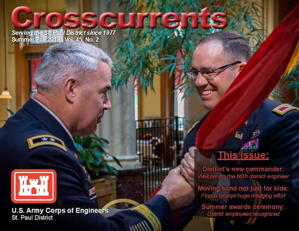 Major Gen. Richard Kaiser, left, presents the Corps of Engineers colors to incoming St. Paul District Commander Karl Jansen during a change of command ceremony in St. Paul, Minnesota, July 10.