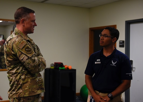 Col. Thomas Flazarano, 21st Space Wing commander, meets with Airman First Class James McKinney, 21st Force Support Squadron fitness specialist, Sept. 6, 2019 at Cheyenne Mountain Air Force Station, Colorado. McKinney is one of the Airmen from Peterson that helps to maintain the fitness centers inside of the Mountain. (U.S. Air Force Photo by Airman Alexis Christian)
