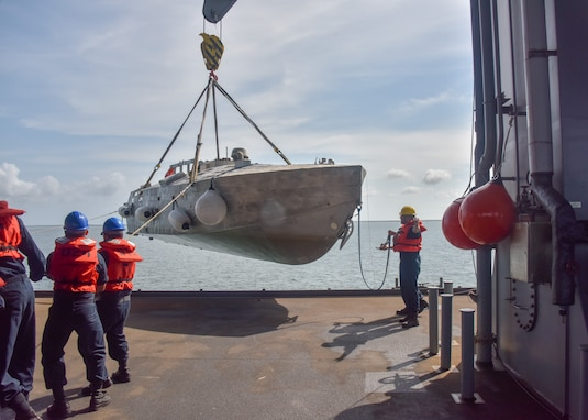 "Naval Surface Warfare Center Panama City Division (NSWC PCD) provided equipment, personnel, and expertise to demonstrate the modular capability of the Mine Countermeasure (MCM) Mission Package (MP) aboard the United States Naval Ship Hershel ""Woody"" Williams (T-ESB 4) earlier this month. NSWC PCD is the lead engineering activity for MCM MP."