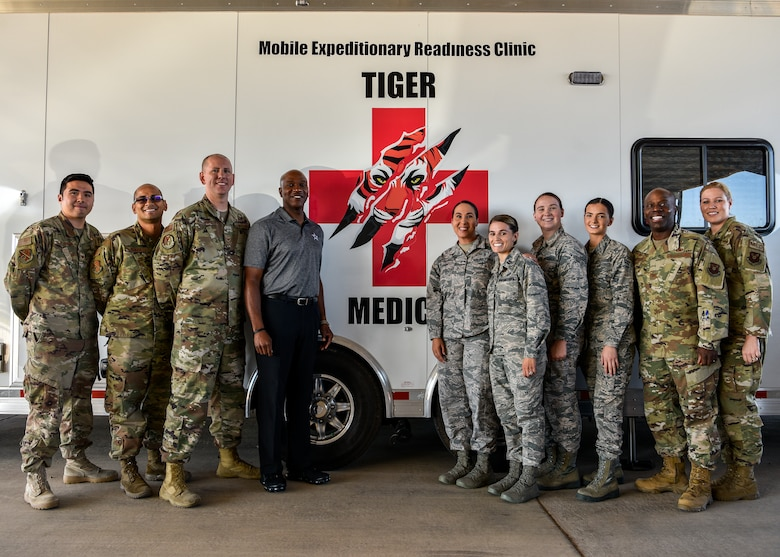 Chief Master Sgt. of the Air Force Kaleth O. Wright poses for a photo with members of the 377th Medical Group in front of the Mobile Expeditionary Readiness Clinic at Kirtland Air Force Base, N.M., Sept. 28, 2019. The MERC allows Airmen to get basic medical care and tasks accomplished right at their units instead of having to leave their work centers to travel to the off-base medical group center. (U.S. Air Force photo by Airman 1st Class Austin J. Prisbrey)