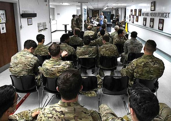 """Service members wait in line to donate blood at Craig Joint Theater Hospital at Bagram Airfield, Afghanistan, Aug. 18, 2019, as part of a """"walking blood bank"""" for a fellow service member being transferred to Brooke Army Medical Center in San Antonio. A request for volunteers with a specific blood type was filled within minutes, providing fresh whole blood to sustain the patient during the lengthy flight home."""