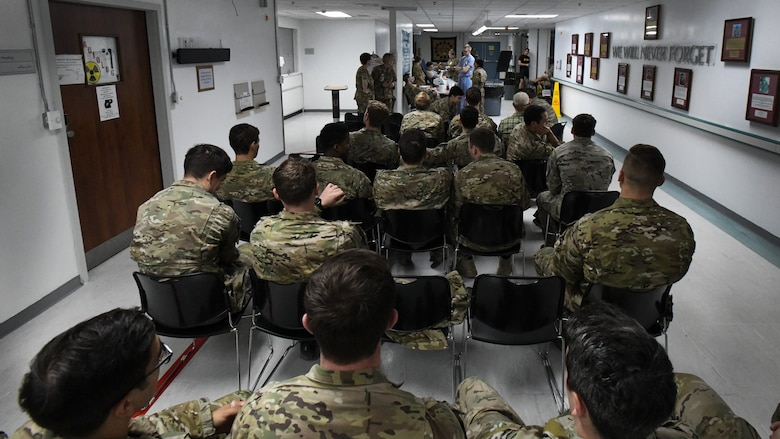 "Service members wait in line to donate blood at Craig Joint Theater Hospital, Bagram Airfield, Afghanistan as part of a ""walking blood bank"" for a fellow service member being transferred to Brooke Army Medical Center, San Antonio, Texas, Aug. 18, 2019. A request for volunteers with a specific blood type was filled within minutes, providing fresh whole blood to sustain the patient during the 20-hour direct flight home. (U.S. Air Force photo by Airman 1st Class Ryan Mancuso)"