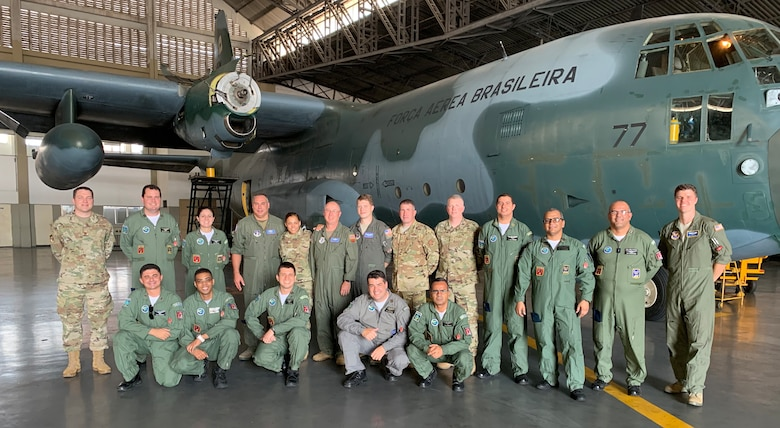 U.S. Air Force Airmen, assigned to the 109th Airlift Wing, New York Air National Guard, pose for a photo with members of the Brazilian Air Force's 1st Squadron, 1st Transport Group at Galeao Air Base, Rio de Janerio, Brazil, during a State Partnership Program exchange Sept. 17, 2019. The 109th AW specializes in Antarctica operations and discussed Artic flying with their Brazilian counterparts. The New York National Guard entered into a state partnership with Brazil in March, 2019. (Courtesy photo)