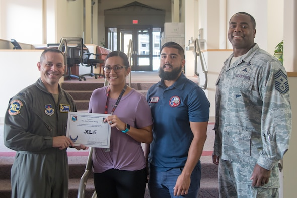 "Ines Torres-Wong, a 47th Force Support Squadron assignments technician, was chosen by wing leadership to be the ""XLer of the Week"" of Sept. 25, 2019 at Laughlin Air Force Base, Texas. For her work in guiding members of Team XL to their next assignments, while improving her office's productivity and performance, Ines Torres-Wong has earned the ""XLer of the Week."" (U.S. Air Force photo by Senior Airman Daniel Hambor)"