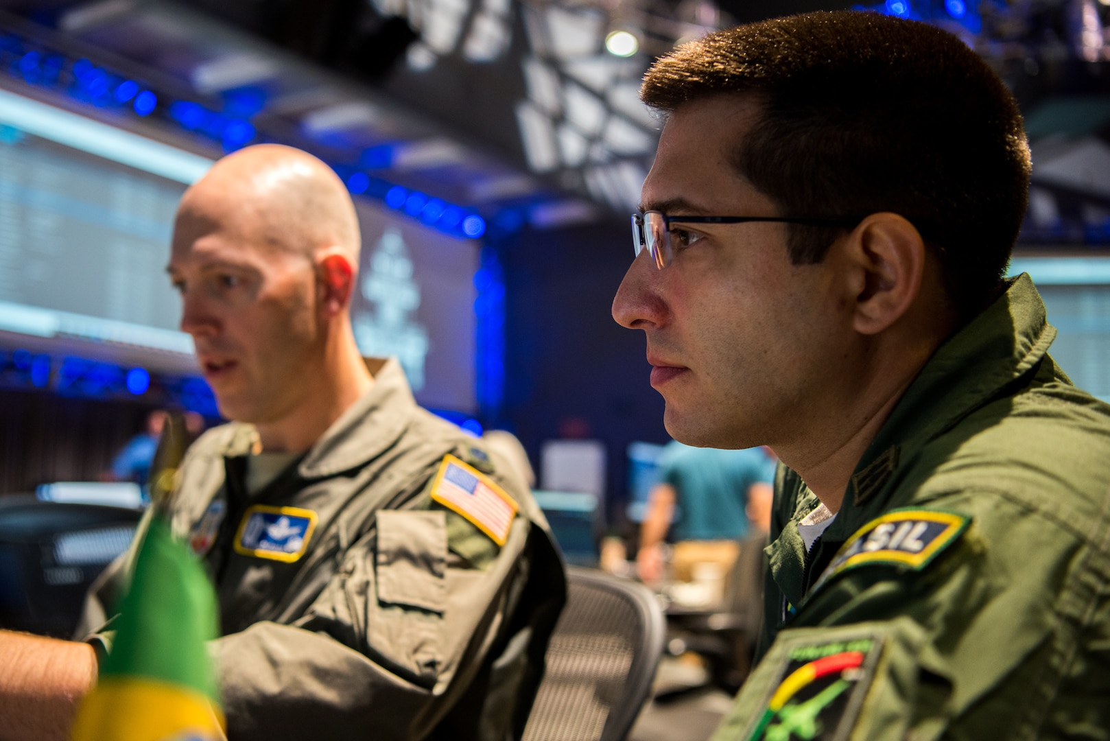 (From Left) U.S. Air Force Lt. Col. Galen Ojala, U.S. Southern Command Director of Space Forces, works with Brazilian Air Force Maj. Rafael de Almeida Duque, Brazilian Aerospace Command, at Lockheed Martin's Center for Innovation in Suffolk, Va., Sept. 27, 2019, during Global Sentinel 19. The event provided an opportunity to develop and implement processes for partners from Australia, Canada, France, Germany, Italy, Japan, the Republic of Korea, Spain, the United Kingdom, the United States to collaborate on space surveillance and spaceflight safety to broaden mutual understanding and enhance cooperation.  (U.S. Air Force photo by Staff Sgt. J.T. Armstrong)