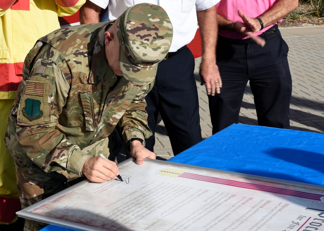 U.S. Air Force Col. Andres Nazario, 17th Training Wing commander, signs the proclamation declaring the second week of Oct. as Fire Prevention Week at the Norma Brown building on Goodfellow Air Force Base, Texas, Oct. 2, 2019. The signing was followed by a fire drill using smoke machines to test the readiness of individuals in the headquarters. (U.S. Air Force photo by Airman 1st Class Zachary Chapman/Released)