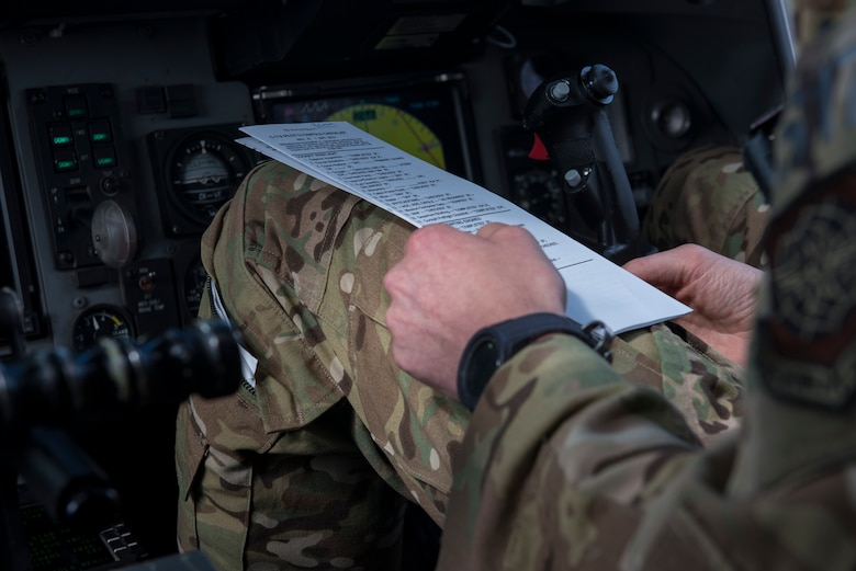 U.S. Air Force Maj. Clark Belfanti, a C-17 Globemaster III pilot assigned to the 14th Airlift Squadron, looks over his in-flight checklist during a local training flight Sept. 26, 2019, over South Carolina. Training missions allow aircrew to maintain currency, training and evaluations in all flying requirements. These training capabilities allow 14th Airlift Squadron Aircrew members to enhance rapid global mobility anytime, anywhere.