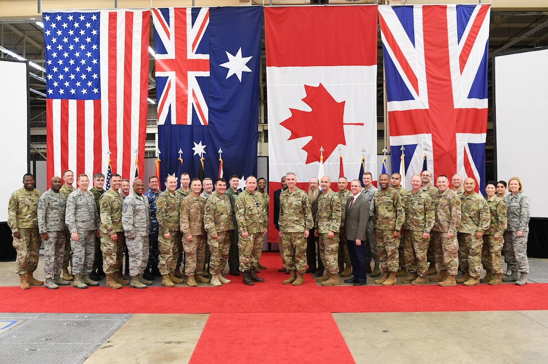 Senior space officials from Australia, Canada, the United Kingdom and the Untied States pose for a photo in the Combined Space Operations Center during a Combined Force Space Component Command Commander's Conference at Vandenberg Air Force Base, Oct. 1, 2019.