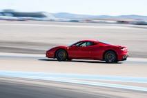 A Ferrari races on a track in Las Vegas