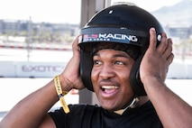 An Airman tries on a helmet at a race track in Las Vegas