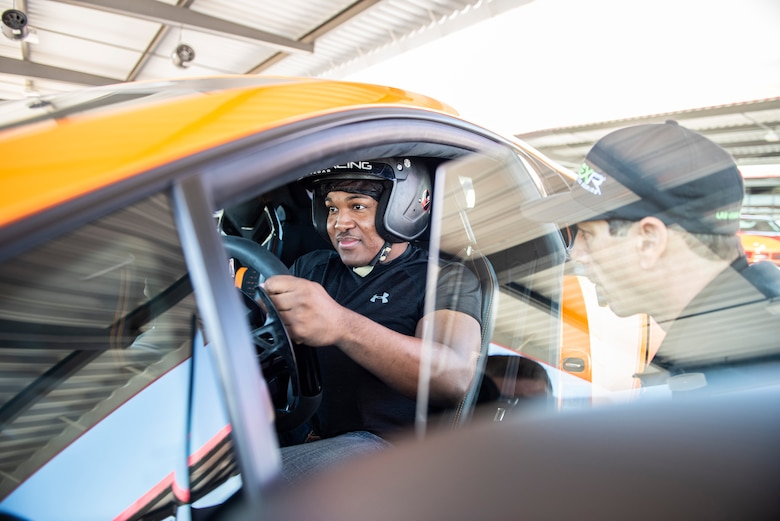 U.S. Air Force Tech. Sgt. Rashodrick Jackson, a transmissions systems section chief assigned to the 99th Communications Squadron, learns the controls of a Lamborghini Huracan Performante at Exotics Racing in Las Vegas, April 3, 2019. Jackson was awarded the experience as part of his squadron's Adventure Training Program. (U.S. Air Force photo by Staff Sgt. Joshua Kleinholz)