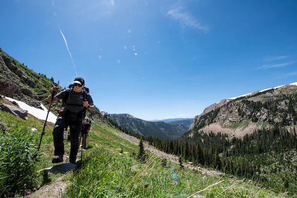 Airmen hike on a mountain in Colorado