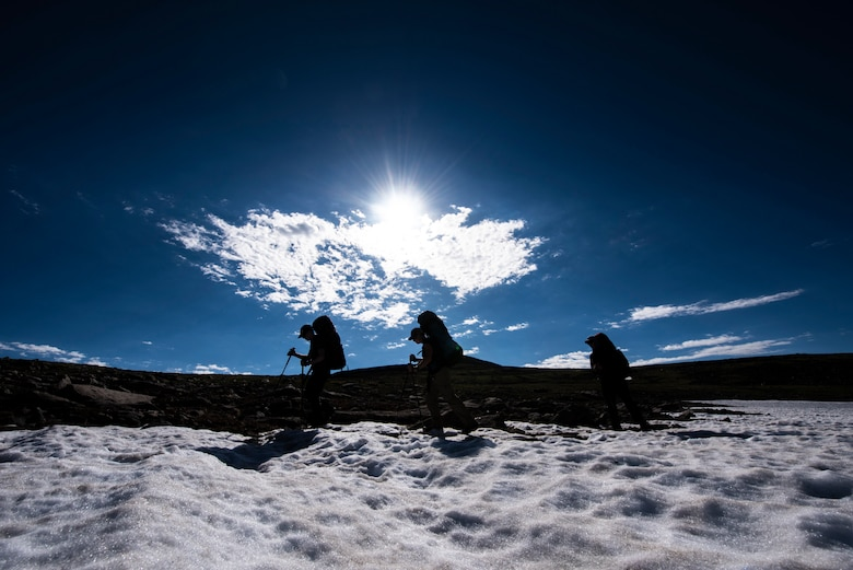 Airmen walk on snow in Colorado