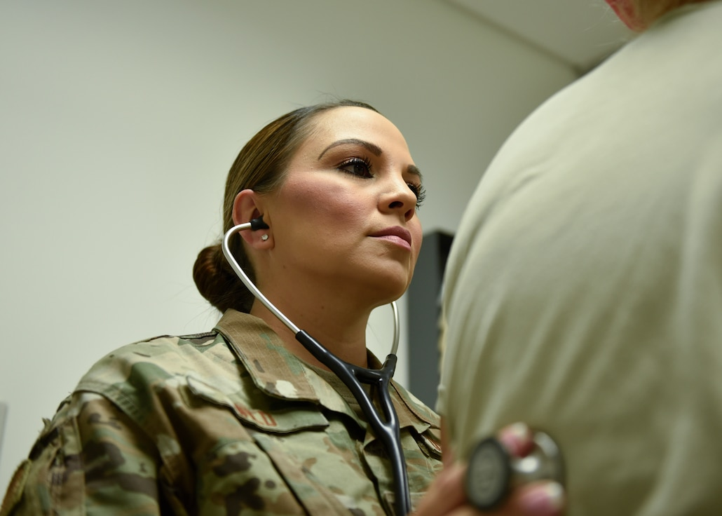 Tech. Sgt. Jerrica Wild, 21st Operational Medical Readiness Squadron independent duty medical technician, checks the breathing of a patient at the clinic on Peterson Air Force Base, Colorado, September 25, 2019. Wild is an Independent duty medical technician, the only enlisted providers in the Air Force, which allows her to diagnose and prescribe medications to patients rather than working through multiple people. (U.S. Air Force photo by Airman Alexis Christian)