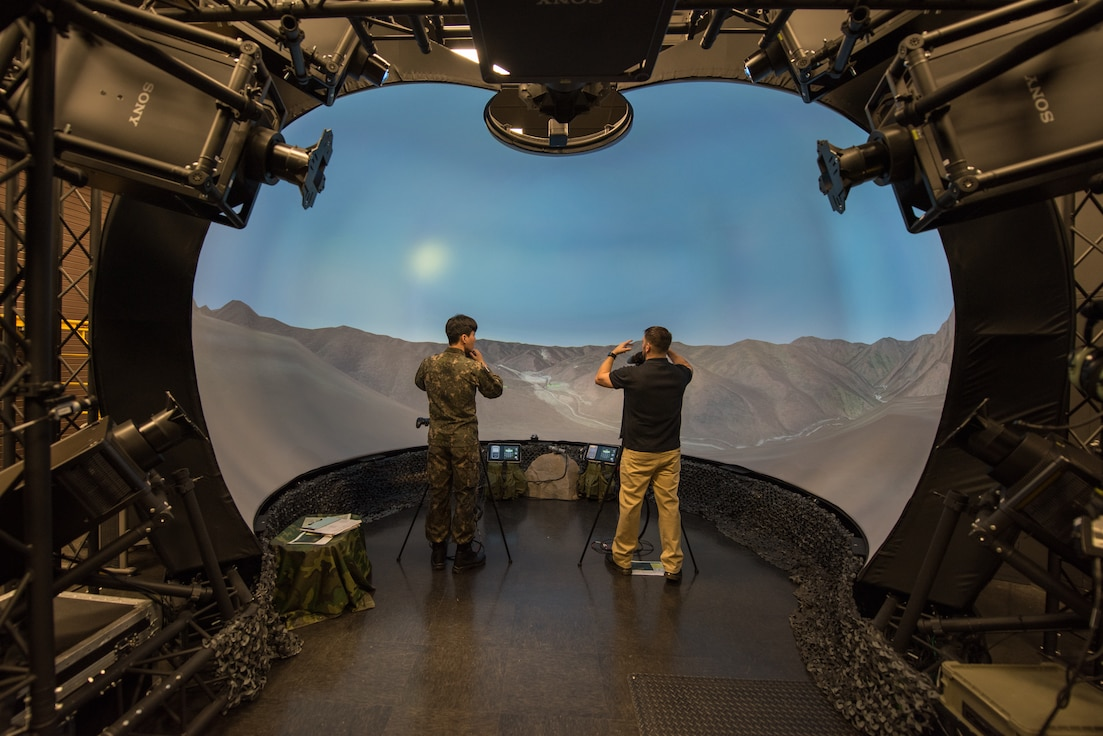 Mike Oser (right), 607th Air Support Operations Group JTAC simulator program manager, explains the functions and equipment on a training simulator for a Republic of Korea Air Force joint terminal attack controller at Osan Air Base, ROK, Sept. 25, 2019. The simulator system provides a realistic environment for JTACs to plan, coordinate and direct surface-to-surface and air-to-surface attacks. (U.S. Air Force photo by Staff Sgt. Ramon A. Adelan)