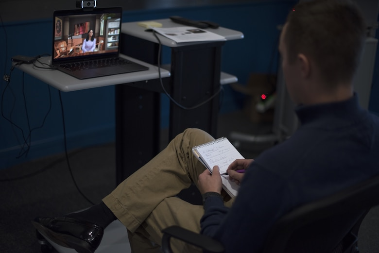 A Flight Commander Course student takes notes during a live simulation – mixing reality leadership experience with artificial intelligence on Joint Base McGuire-Dix-Lakehurst, New Jersey, Sept. 27, 2019. Instructors included the simulation into the course to allow flight commander's the opportunity to utilize the tools such as emotional intelligence, feedback and First Sergeants. (U.S. Air Force photo by Airman 1st Class Ariel Owings)