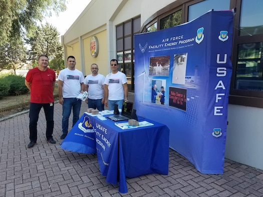 Members of the 39th Civil Engineer Squadron Base Energy Management team pose at a booth outside the Base Exchange Oct. 5, 2018, at Incirlik Air Base, Turkey, to kick off Energy Action Month. October is designated as the month to educate Air Force members on the importance of reducing energy and water use. (Courtesy photo)